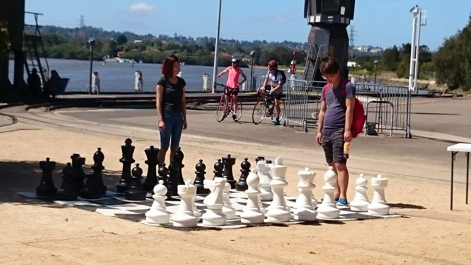 Chess next to the Armory Wharf Canteen