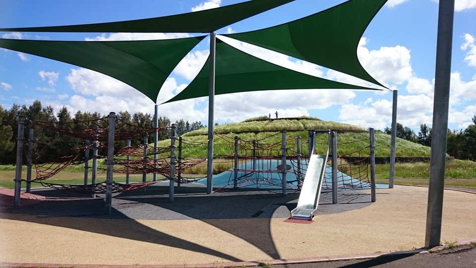 Small playground with shade sail
